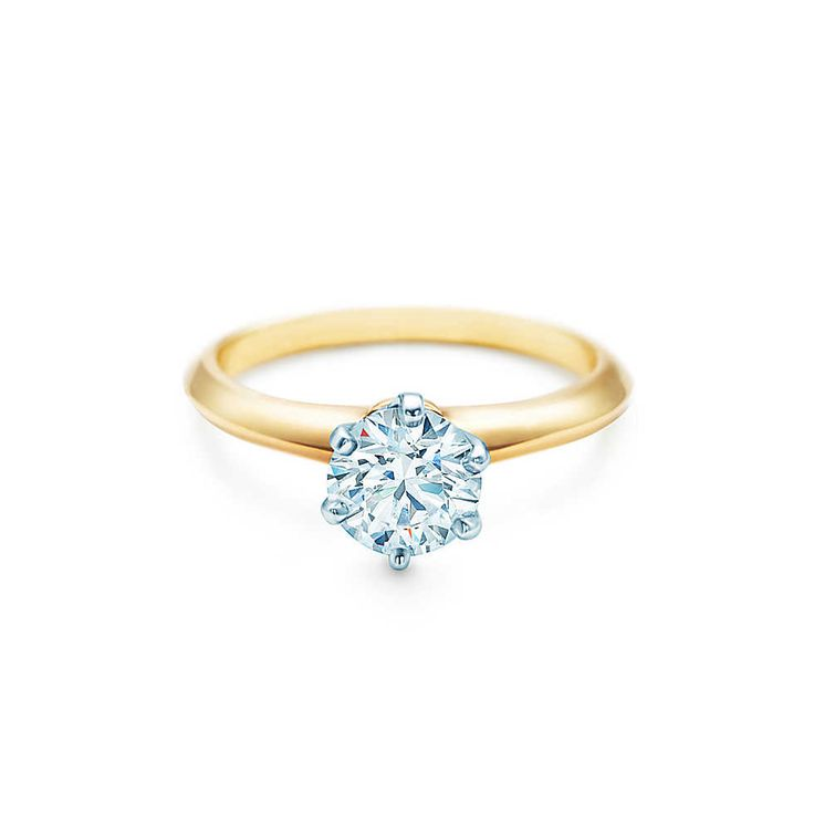 Tiffany & Co. -  The Tiffany® Setting 18K Yellow Gold... The only engagement ring I'd ever consider wearing. He wants me, he'll buy it.