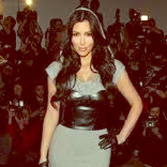 Kardashians Bebe hooded dress with leather bustier Kim Kardashian wearing Kardashian line for Bebe mini dress size extra small. Hooded heather grey dress with a leather bustier attached on to it for a little sexy edge. I am 5ft2 in photos you can see the dress is a short mini I had the seamstress take an inch or two off because original it went down to my knees perfect for any cute lil girls who are short like me  bebe Dresses Mini