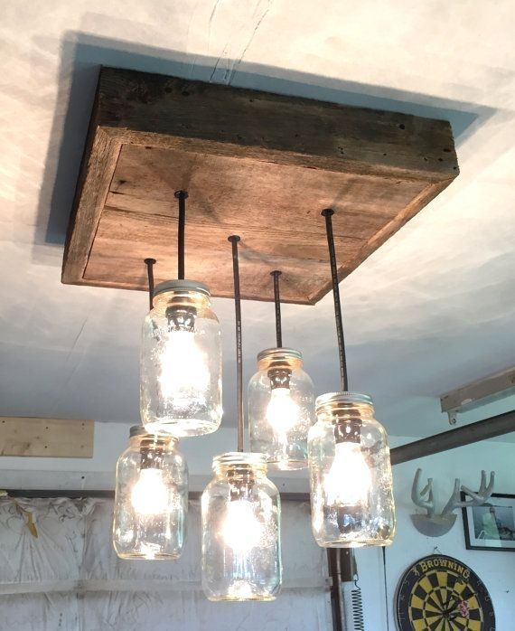 This rustic barnboard mason jar chandelier will bring