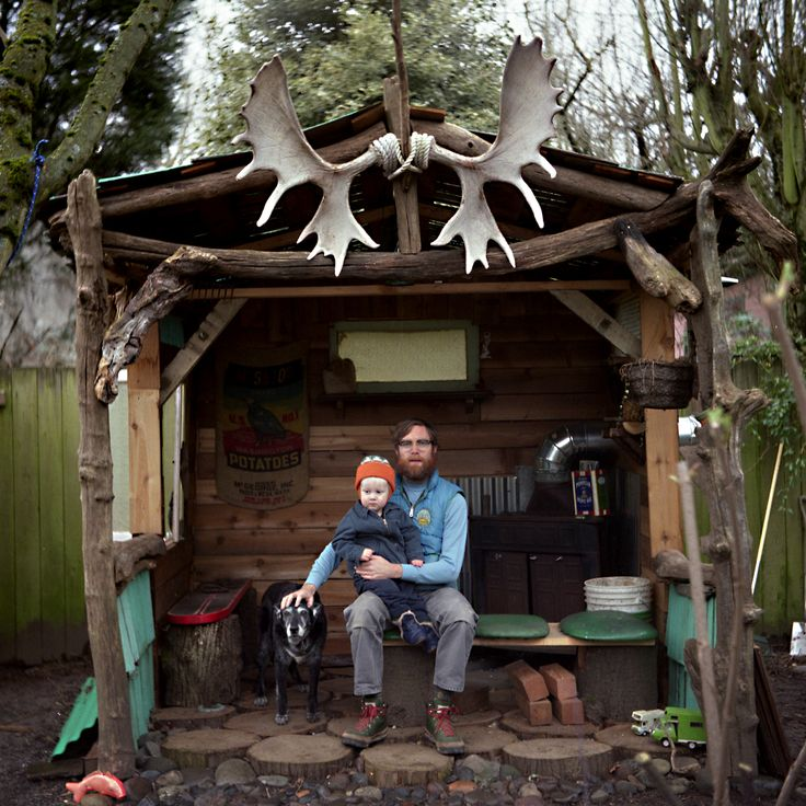 """Justin """"Scrappers"""" Morrison, his son Camper, and their dog Bamboo in a backyard cabin in Portland, Oregon."""