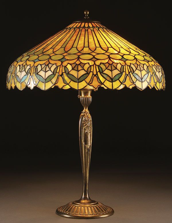 A duffner adam pattern leaded glass and gilt bronze table lamp