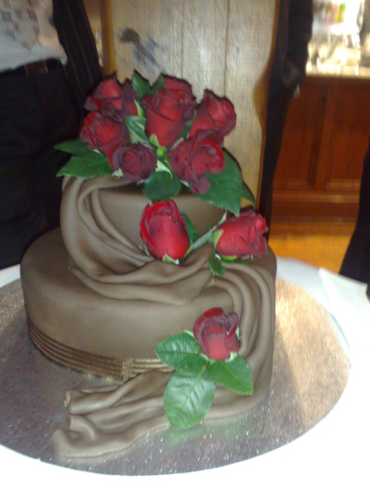 Draped chocolate wedding cake with Real roses