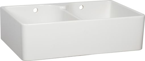 A traditional Belfast sink with discrete chrome wastes and a deep, generous bowl to accommodate the largest roasting pan from Neptune