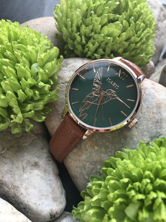 Isabis Botanica Colibri by ISABIS WATCH. Intricate MOULDED DETAILS details of a gorgeous feminine hummingbird embellish a darling and vintage feeling round face timepiece, highly polished rose gold watch paired with a complementary tan pineapple vegan leather strap.