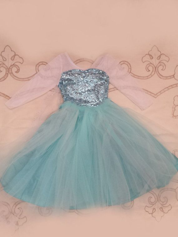Frozen Elsa inspired dress Hello and welcome to my shop. If purchasing give about 2 weeks to receive your dress, this dress is intended