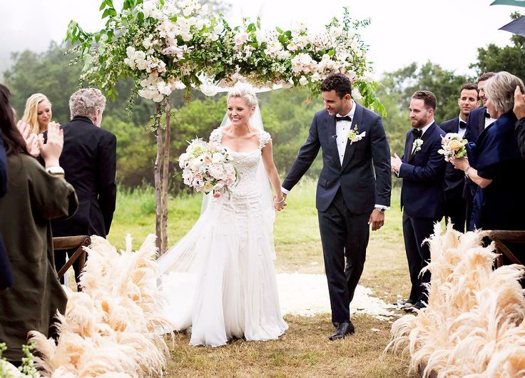 Wedding Dresses:   Illustration   Description   Empire star Kaitlin Doubleday wed DJ Devin Lucien in a gorgeous white custom made Mark Zunino A-line wedding dress with a sheer back decorated with floral appliques    -Read More –   - #WeddingDresses https://adlmag.net/2018/01/01/wedding-dresses-empire-star-kaitlin-doubleday-wed-dj-devin-lucien-in-a-gorgeous-white-custom-mad/