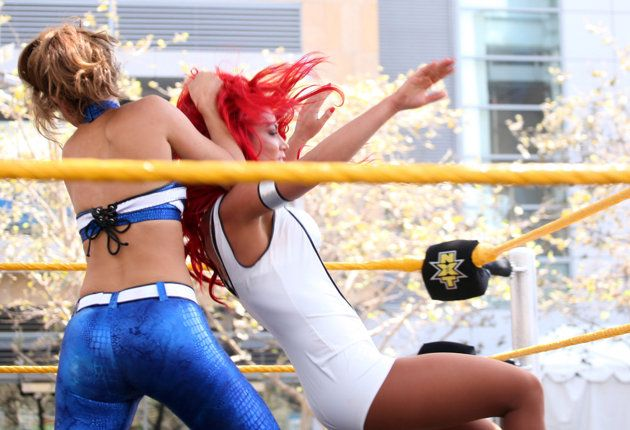 Maria Menounos Wrestles With WWE Divas While Wearing Flashy Spandex Suit | omg! - Yahoo! omg!