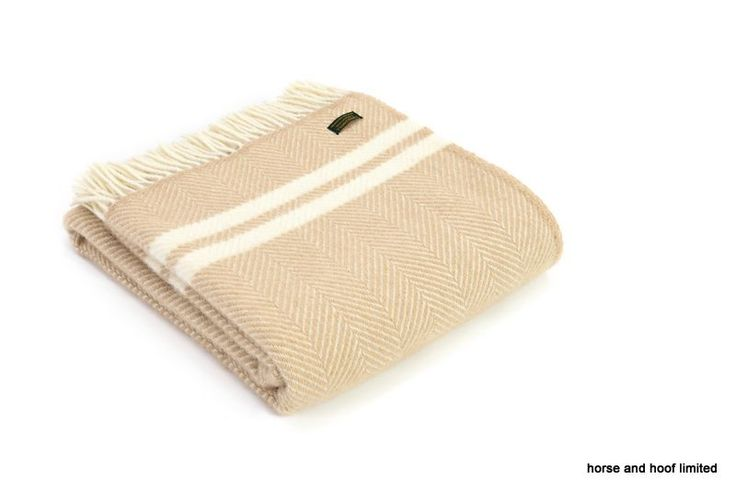 Tweedmill Lifestyle Pure New Wool Fishbone Two Stripe Throw - Beige Cream A beautiful high quality throw ideal for the bottom of a bed, a throw for a chair or sofa or simply as a traditional blanket to keep you warm and comfortable on cold wintry nights.  Available in two sizes:- Full Size 150cm x 183cm Knee Rug 70cm x 183cm  Tweedmill Textiles of Wales - woven in Denbigh on the edge of the Clwydian mountain range in North Wales, an area steeped in textile history and inspirational natural…