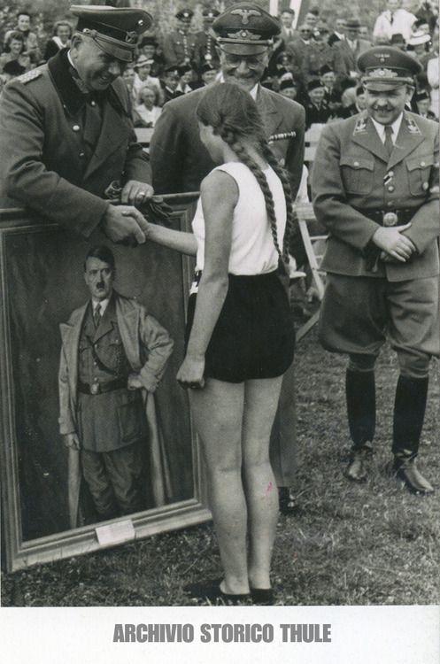 Girl of the Bund der Deutsche madel a part of the Hitlerjugend wins a pprtret of the Führer Adolf Hitler