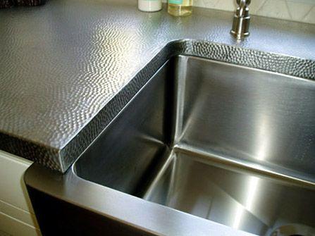 Elegant Brushed Reverse Hammered Stainless Steel Countertops.