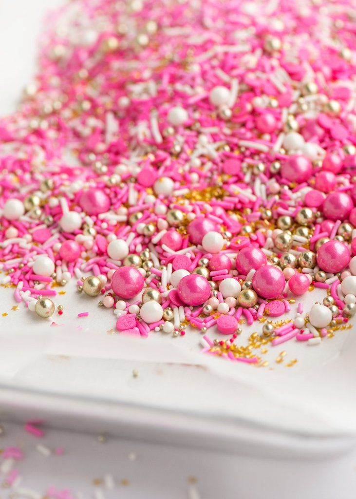 FLAMINGO Twinkle Sprinkle Medley is a premium, one of a kind mix of fancy flamingo-inspired sprinkles in the universe: bright and light pink strands, white stra