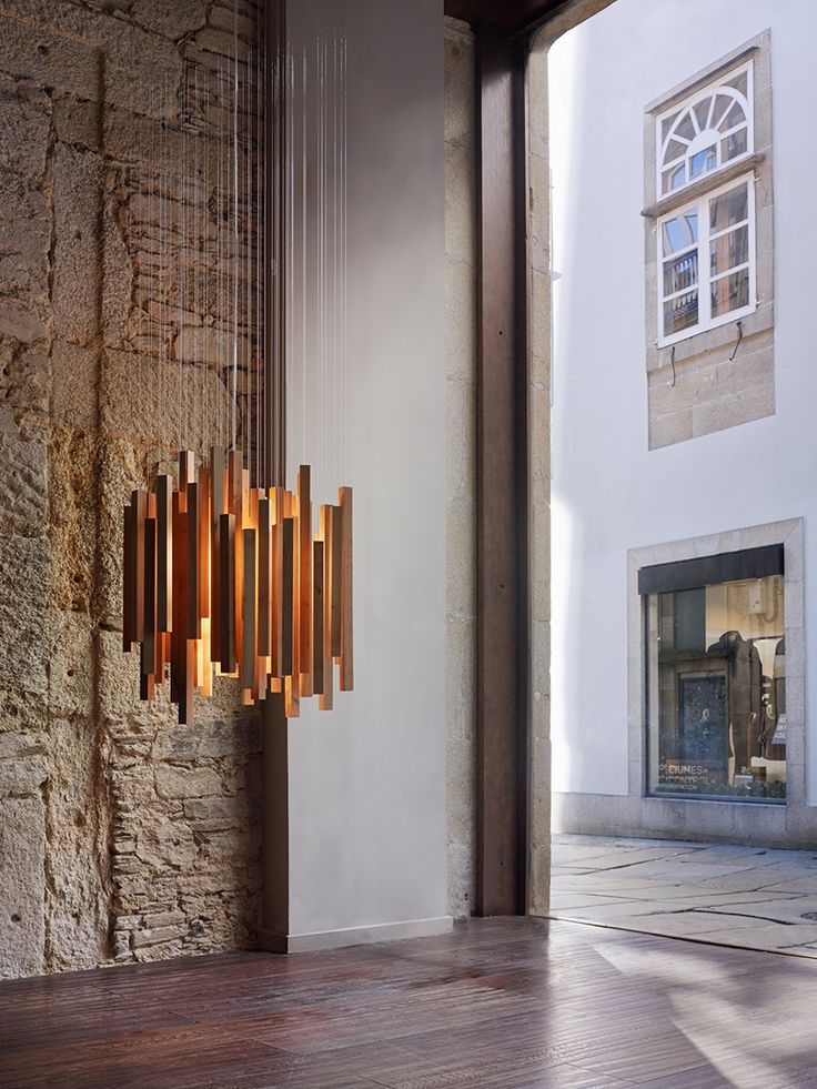 Woods pendant lamp arturo alvarez handmande unique lighting designed by héctor serrano this pendant lamp made with suspended wood pieces