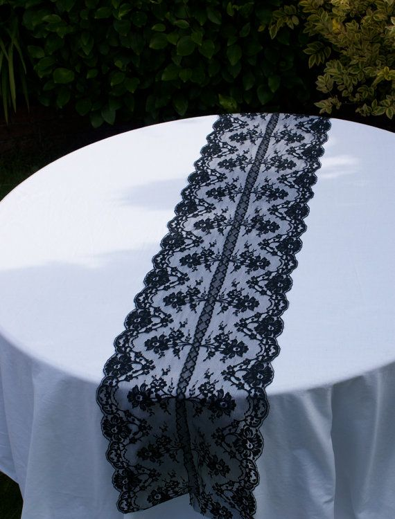 Black lace table runner for your special day. $26.00, via Etsy.