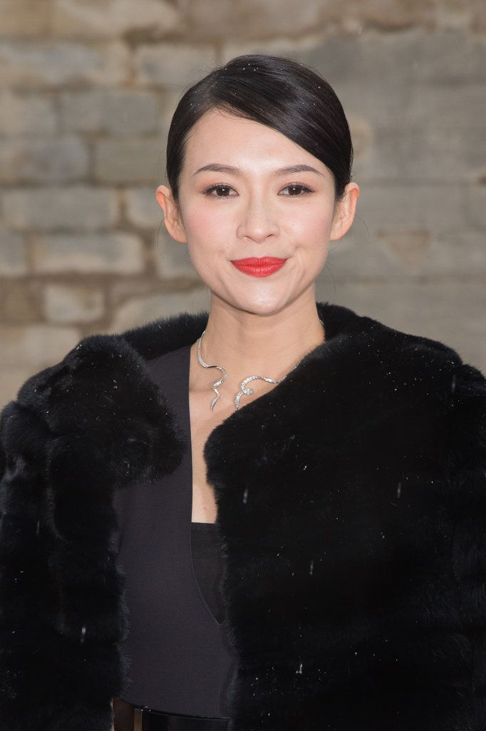 Zhang Ziyi: Even though there were snow flurries at the Dior presentation, Zhang Ziyi turned up the heat with a red-orange lip color and flawless skin.