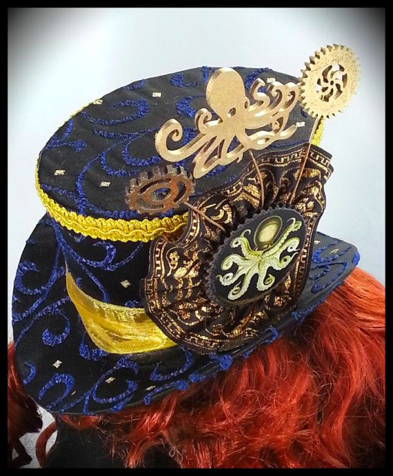 A Steampunk ladies Mini top hat, finished ready to ship, This is a mini top hat!! Not full sized.  Easy to attach with Hidden elastic strap and loops for grips. Navy blue and gold.  I dont make custom hats to order , just what is in stock is for sale ! Hand made from our own patterns Harlots and Angels