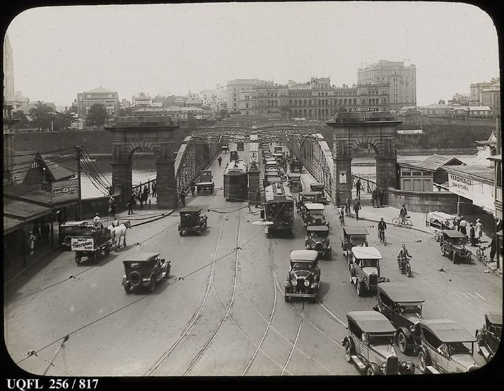 Southern end of the Victoria Bridge public (trams) and private (cars) transport c1930s. All but the southern bridge arch, Treasury Building (seen over arch), Bank and Taxation Office behind it demolished. Another remainder is the City Hall tower extreme right.