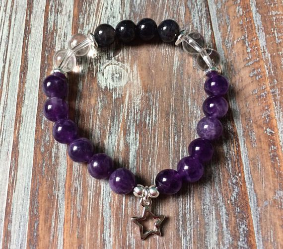The Violet Energy mala bracelet is designed with crystals that have a high vibration. Violet energy is associated with our crown chakra and soothes mental and emotional stress. Violet energy slows down an overactive heart and mind and aids with depressive symptoms. #malabeads #gemstonejewelry #gemstonebracelets #crystals #crystalhealing #violetmoonmala #amethyst