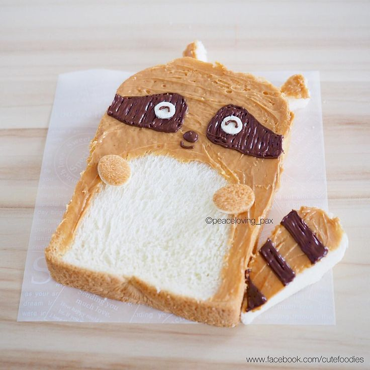 Happy morning with smiling raccoon peanut butter toast