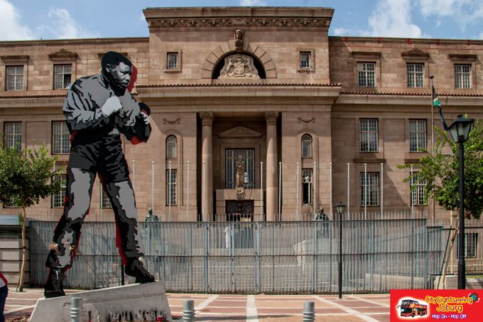 """View Nelson Mandela's """"Shadow Boxer"""" statue outside the Johannesburg Magistrates Court, just opposite Chancellor House. http://www.citysightseeing.co.za/MiningDistrictWalk.php"""