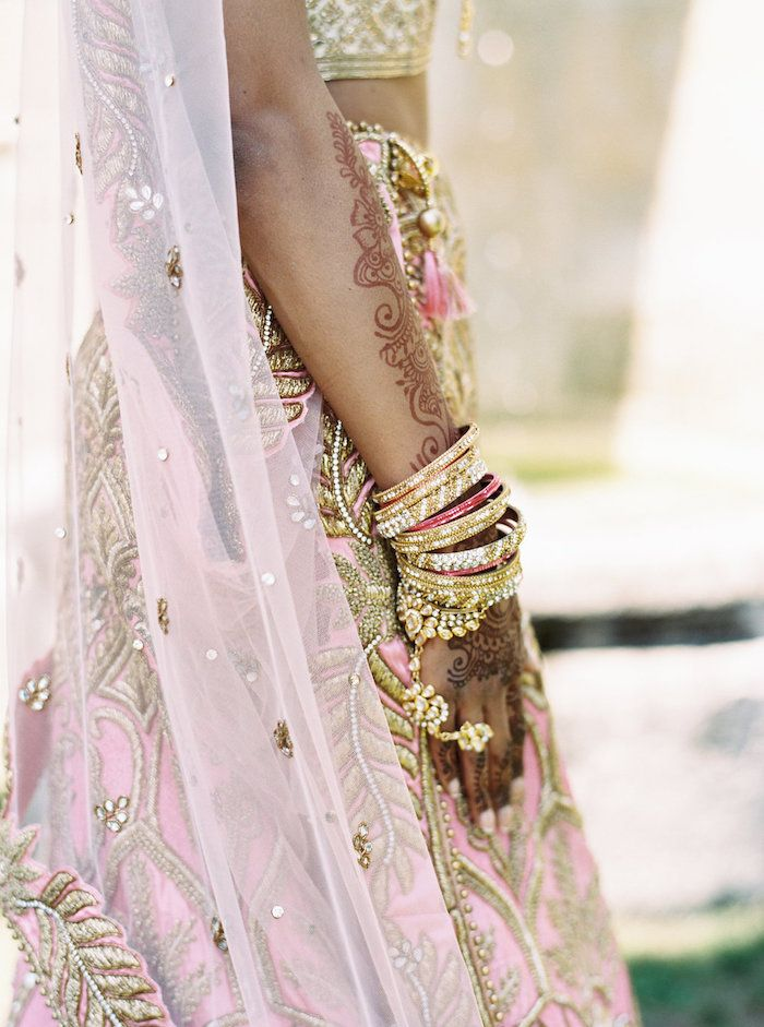 stunning henna tattoos and gold and pink bangle bracelets