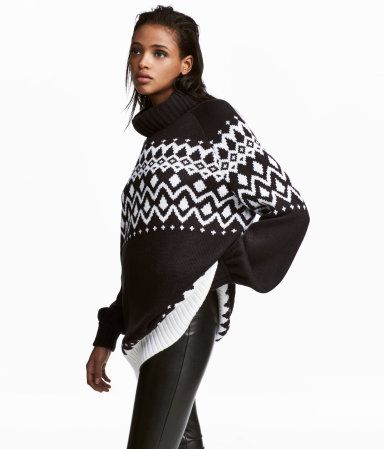 Black/patterned. Slightly longer turtleneck sweater in a soft jacquard knit. Long balloon sleeves and ribbing at cuffs and hem.