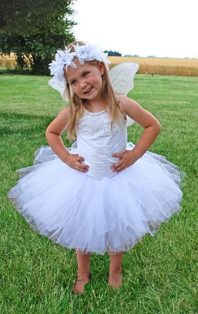 angels - tutu tulle skirts, white long sleeve tops, white wings, halos, white tights? hair up or down?