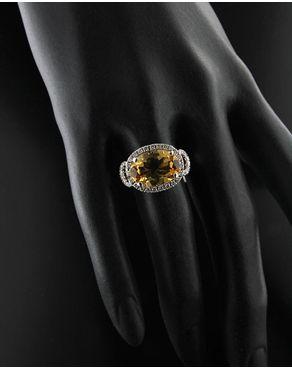 Δαχτυλίδι λευκόχρυσο Κ18 με Διαμάντια και Τοπάζι