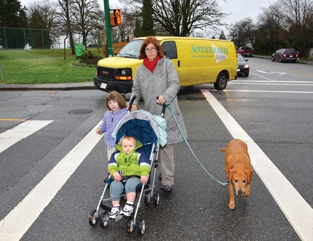 Concerned: New Westminster resident Andrea Mears crosses at the intersection of Cariboo Road and 10th Avenue with her children Ainsley, 4, and Lachlan, 14 months, and her dog, Ginger. She says drivers speed through the area and come around the corner without looking for pedestrians.