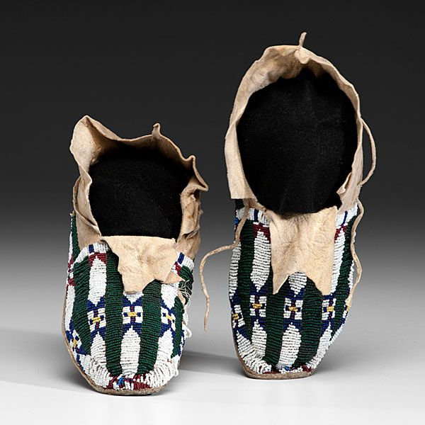 Cheyenne Beaded Hide Moccasins, thread-sewn on softly tanned hide; beaded using colors of bottle green, dark blue, pea green, greasy yellow, and rose, length 10.5 in. ca 1900