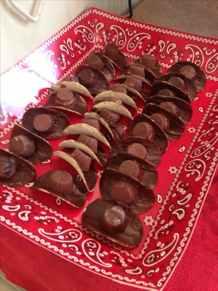 We made these cute and delicious cowboy hats by icing one side of a Pringles (regular flavor) chip with melted chocolate and then topping with an unwrapped Reese's peanut butter cup.  If a bit of chocolate pulled off the bottom of the Reese's when we unwrapped it, we added a little melted chocolate to it, too.  These were a big hit.  Enjoy:)