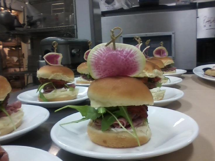 Our Chef Ivan Flowers went crazy & created this... Pazzo Meatball Sandwich- Sliced Meatball, Genoa Salami, Mascrapone, Confit Tomato, Arugula & Parmesan Pesto.