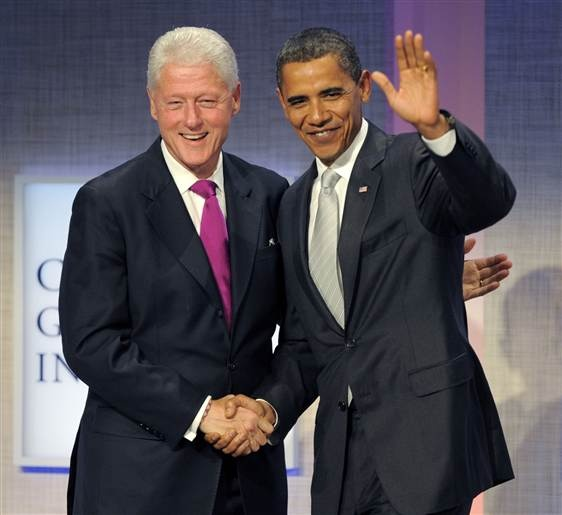 Barack Obama and former president Bill Clinton shake hands during the Fifth Annual Meeting of the Cinton Global Initative in New York City on Sept. 22, 2009. (Timothy A. Clary / AFP - Getty Images)