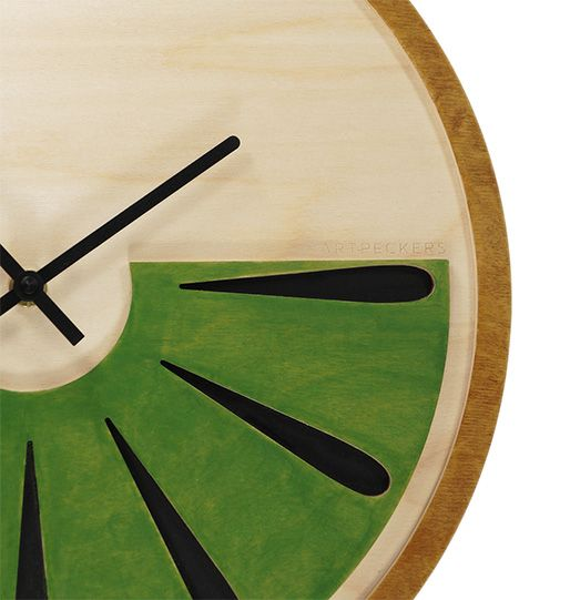 It's kiwi time! // a clock for those who adopt a special style. It is made of three pieces of birch plywood assembled in a way that emphasizes the inside part of the fruit with its peel. It comes to remind you all those moments that you tasted its special and rare taste.