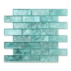 i'm quite a fan of glass tile backsplashes in fun, bright colors like this one! i'd pair it with some dark espresso cabinets with those lil lights under the cabinets to really throw some light on these tiles :)