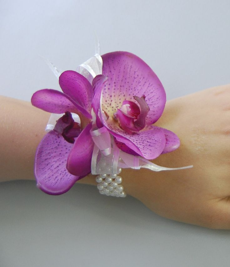 Orchid wrist corsage -- for the mamas? I like the faux pearl instead of ribbon. Mom likes orchids and Casablanca lilies best