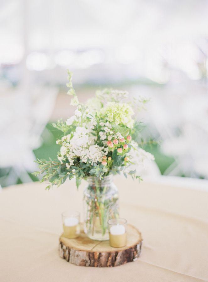 Rustic chic mason jar wedding flowers: http://www.stylemepretty.com/wisconsin-weddings/2016/08/24/rustic-northwoods-wedding/ Photography: Natashia Nicole - http://natashianicolephotography.com/