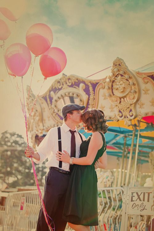 Balloons, a Carousel, fancy clothes and a forehead kiss. Love. #kiss #kisses #kissing #couple #love #passion #romance #fairground #carousel