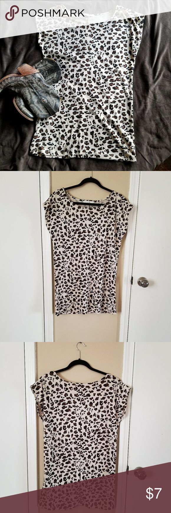 Animal Print Mini Dress Animal Print Mini Dress. Measures approximately 28 inches - has been worn as a mini dress - be aware it is pretty short - See photo for fabric content. Pre-owned in good condition. Dresses Mini