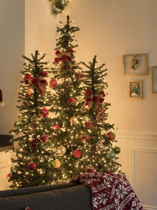 This trio of tannenbaum evergreen trees can support a good for Number of ornaments for christmas tree