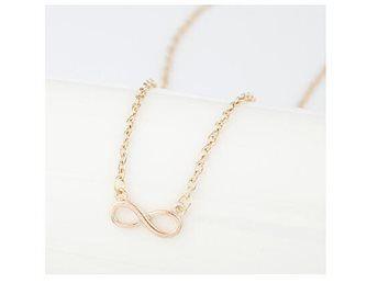 Fint halsband långt med ögla guldfärg NY modernt coolt