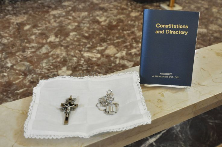The Crucifix, Emblem of the Gospel and Constitutions of the Daughters of St. Paul received at First Profession