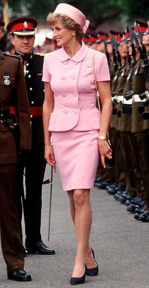 1995     Gianni Versace designed her Jackie O-inspired pink suit for a visit to the nation's troops. Her pillbox hat was from Philip Somerville.