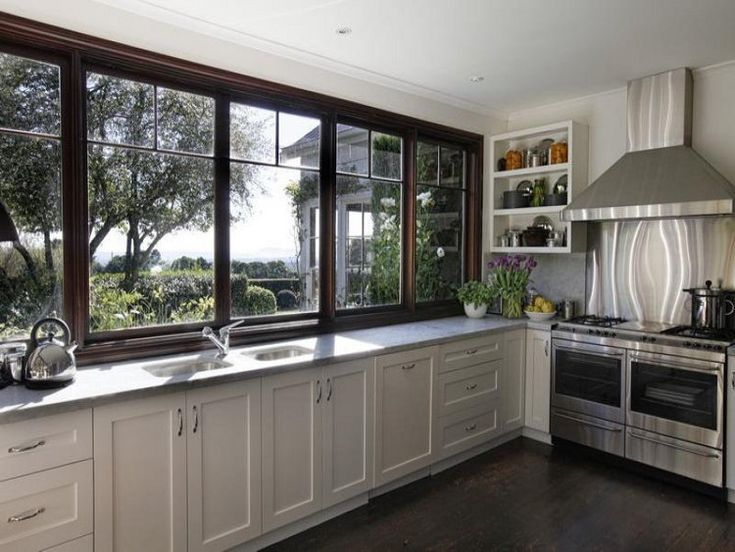 no upper cabinets. just these windows. to make dish washing so much better.
