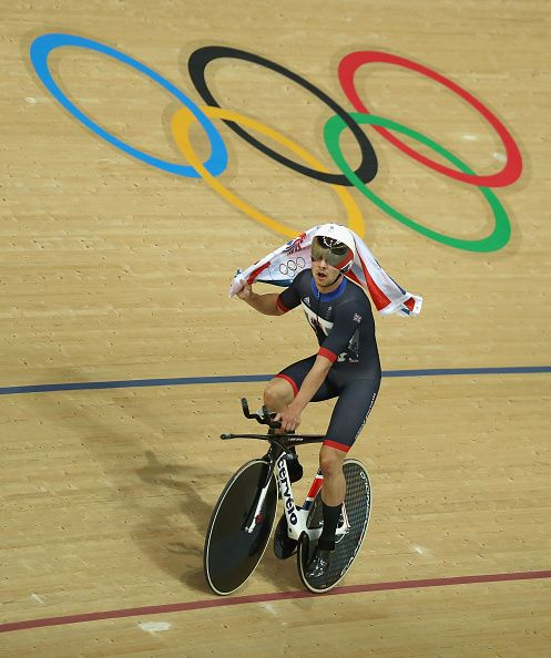 Owain Doull of Team Great Britain celebrates winning the gold medal after the…