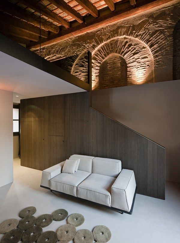 Must sofa and Funghi rug, in the Hotel Caro, all three designed by Francesc Rife