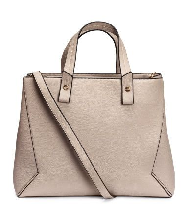 Handbag in grained imitation leather with two handles and a detachable shoulder strap at top. Flap with magnetic fastener and divided compartment. Three inner compartments, one with zip. Lined. Size 7 x 11 1/2 x 15 in.