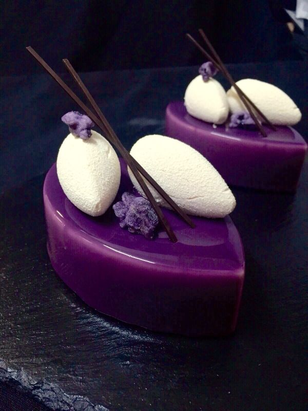 "Nina Tarasova - ""Violet."" Pistachio sponge cake; blackberry jelly; violet mousse with raspberry; mirror glaçage and chocolate decoration."