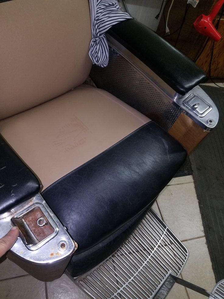 This old barber's chair at my local barber shop has ashtrays in the arm rests.