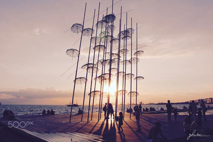 U M B R E L L A S - Magical sunset behind the Umbrellas in Thessaloniki, Greece