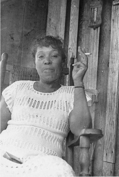 Photograph of Zora Smoking taken by Robert Cook, or Stetson Kennedy. Cross City, Florida. 1939.